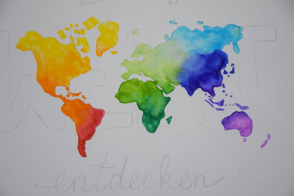Handlettering Welt entdecken ausgemalte Weltkarte